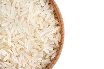 Close up of wooden bowl filled parboiled rice on white background. Healthy food. Top view, high resolution product
