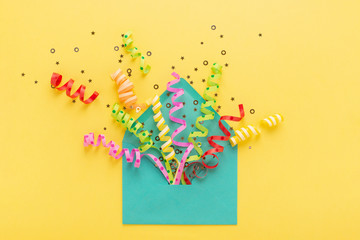 Colorful party confetti in envelope.