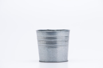 Metal pot on white background