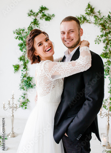 Groom And Bride Posing Smiling In Studio For Wedding Shot Day