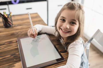 Little Girl Drawing Digital Picture On Electronic Touch Pad With Bluetooth Pen