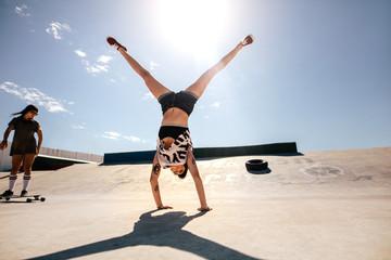 Girls doings stunts at skate park