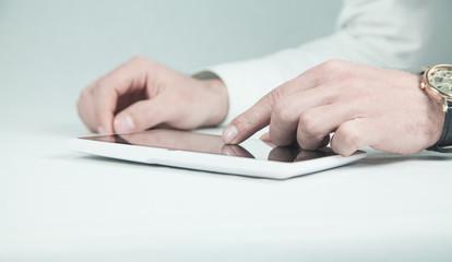 Man using white digital tablet.