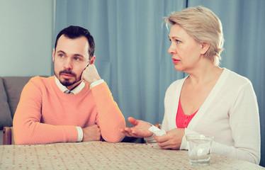 Mature mother and son quarrel