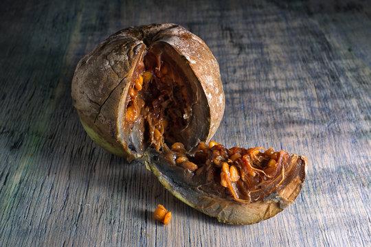 cut borojo fully ripe fruit closeup on wood surface