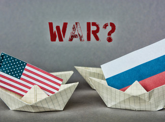 paper ship with Flags of USA and Russia. conflict in Syria sea, concept shipment or free trade agreement and membership.