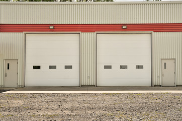 Door stickers Industrial building Industrial warehouse with white roller doors and standard door both sides.