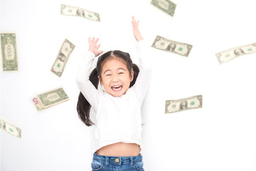Portrait of cute little asian girl throwing money isolated on white background. Small toddler asian girl counting her allowance dollar note.