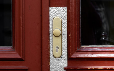Door handle on a red wooden door