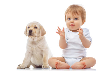 Baby boy with puppy, isolated on white