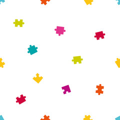 Seamless pattern of colorful jigsaw puzzle pieces.