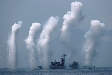 Flares are set off from Cheng Kung-class frigate (1101) during a drill near Yilan naval base