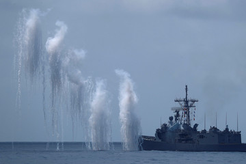 Flares are set off from Cheng Kung (PFG-1101) Cheng Kung class frigate (Oliver Hazard Perry class) during a drill near Yilan naval base
