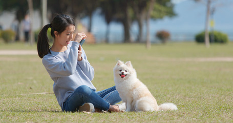 Woman taking photo with her dog