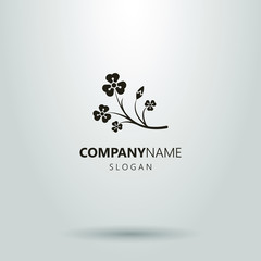 logo of a branch of wild flowers. a simple black and white pictogram. frameless icon