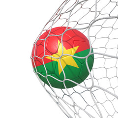 Burkina Faso flag soccer ball inside the net, in a net.