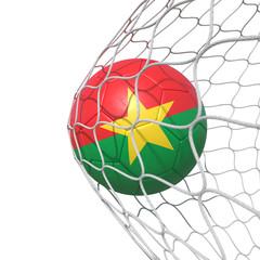 Burkina Faso flag soccer ball inside the net, in a net.