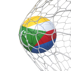 Comoros Comoran flag soccer ball inside the net, in a net.