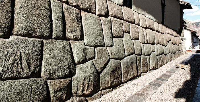 Hatun Rumiyoc street with Incan twelve angle stone in Cusco, Peru.