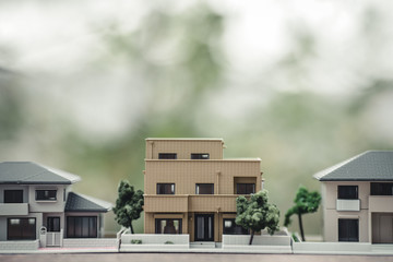 住宅模型と緑ぼかし