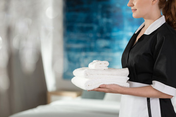 Housemaid holding washed towels