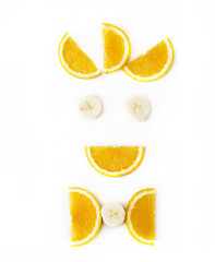 funny face of orange and banana slices