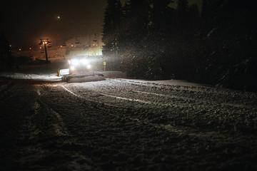 snow machine cleaning snow in dark