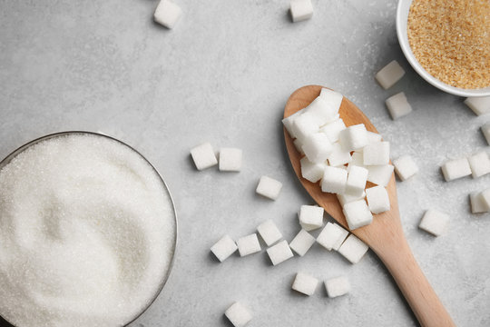 Composition with various kinds of sugar on gray background