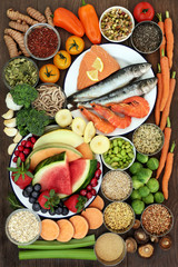 Health food sampler with super food high in omega 3, antioxidants, vitamins, anthocyanyns, fibre and minerals with fresh seafood, fruit, vegetables, seeds, grains, cereals, pulses, herbs and spices.