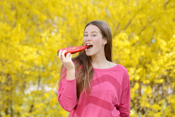 Beautiful attractive young woman holding healthy detox vegetable. Healthy lifestyle concept.
