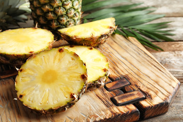 Pineapple slices on wooden board