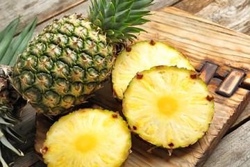 Fresh pineapple on wooden board