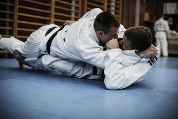 Judo training . Young males.