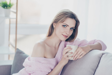 People refreshment person concept. Close up portrait of charming delicate calm meditative relaxed beautiful dreamy attractive lady drinking hot green herbal tea leaning on the back of divan