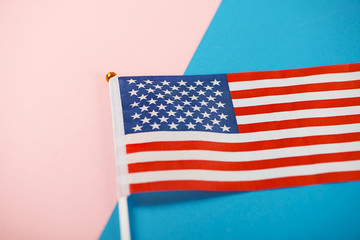 United States of America flag on pink and blue background. Minimalist.