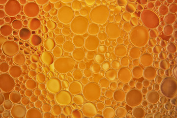 Background with bubbles of oil on water