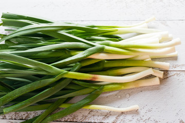 young green garlic on a wooden background