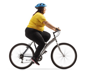 Overweight woman riding a bicycle