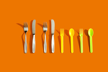 Four Sets of Cutlery on Orange Background representing the concept of family