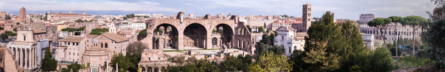 An ultrawide view of the Antoninus and Faustina Temple, Temple of Romulus, Basilica of Maxentius, Basilica de Francesca Romana and the Colosseum