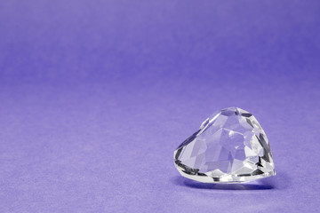 A glass diamond set against a brightly coloured background