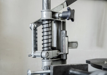 Mechanism with a spring, press