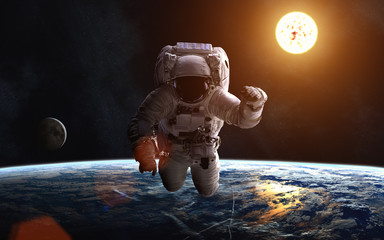 Astronaut. Earth's cosmic landscape. Moon. Solar System. Image in 5K resolution for desktop wallpaper. Elements of the image are furnished by NASA