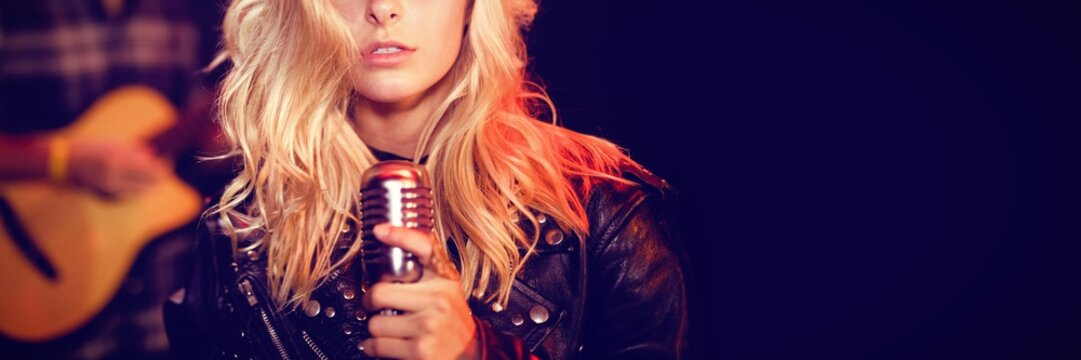 Portrait of female singer with blond hair