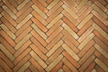 Top View To The Old Brown Sidewalk From Bricks In A Herringbone Layout