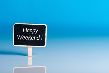 Happy Weekend words on little tag at blue background with empty space for text, template or mockup