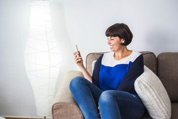 nice girl at home with mobile phone