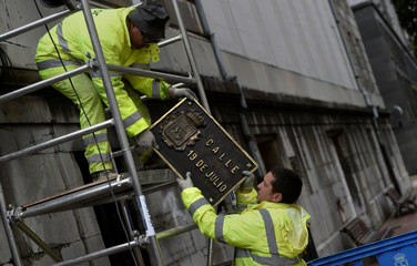Workers remove street plates with Franco era references, in appliance to Spain's law of Historical Memory which forbids public places or entities to be named with references to Spain's former dictatorship in Oviedo