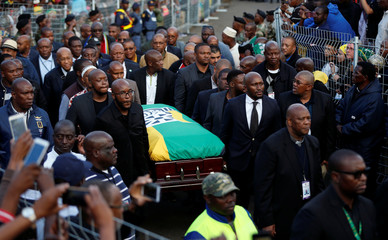Mourners carry the coffin of the late Winnie Madikizela-Mandela in Orlando West, Soweto