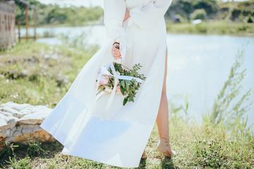 Beautiful bride on the river Bank. Beautiful bride posing.